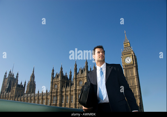 A businessman in front of the house of parliament - Stock Image