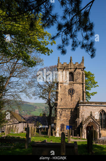 Eyam parish church of Saint Lawrence in the Derbyshire Peak District UK - Stock Image