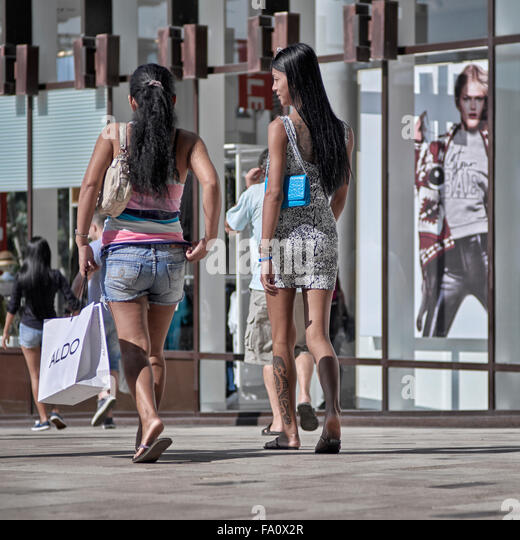 Young females shopping. - Stock Image
