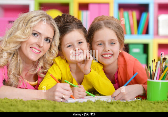 Mother with daughters drawing  - Stock Image