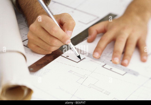 Architect editing blueprint, close-up - Stock Image