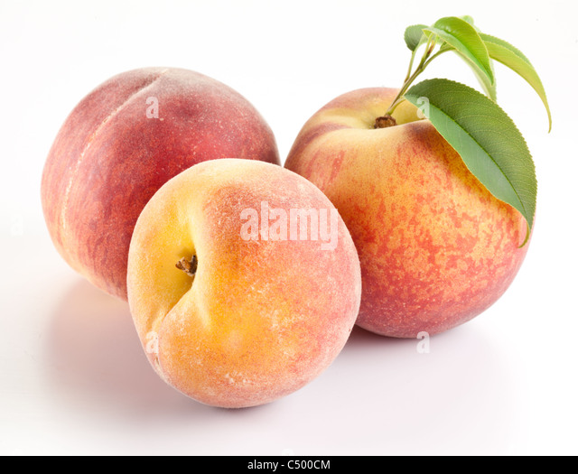 Three ripe peach with leaves on white background. - Stock Image