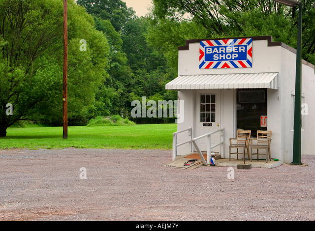 Small barber shop with bold sign - Stock Image