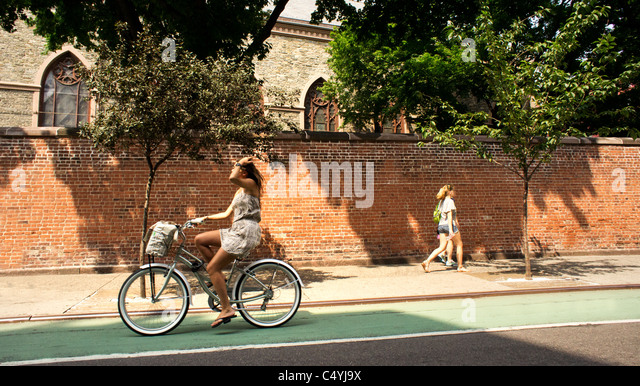 Young woman on bicycle in Lower Manhattan. Stock Photo