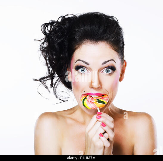 Ecstasy. Funny Peppy Woman with Yummy Lollipop - Stock Image