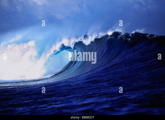 A stunning wave curl reveals impossible shades of blue Tavarua Fiji Islands - Stock Image