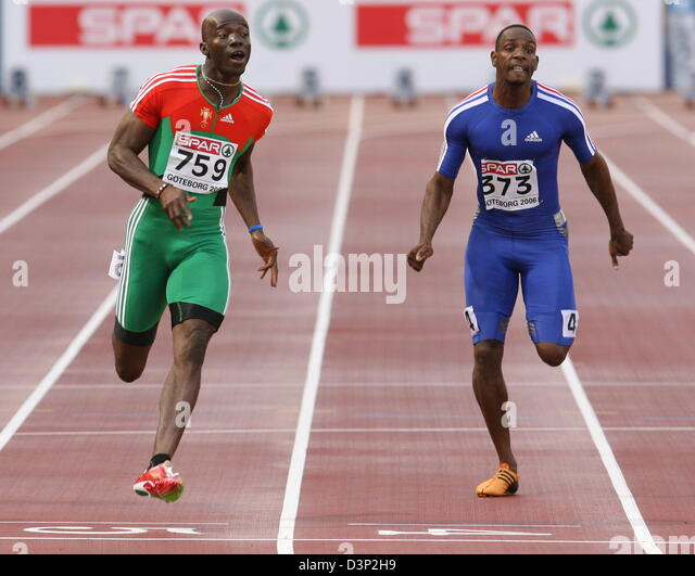 Portuguese Francis Obikwelu (L) wins ahead of French Ronald Pognon the men's 100 metres title at the 2006 European - Stock Image