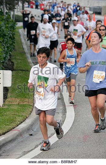 Miami Beach Florida Blue Cross and Blue Shield Tropical 5K Run race runner sports fitness boy boys woman teen road - Stock Image