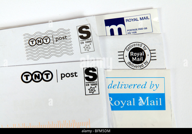 TNT Post & Royal Mail postage labels - Stock Image