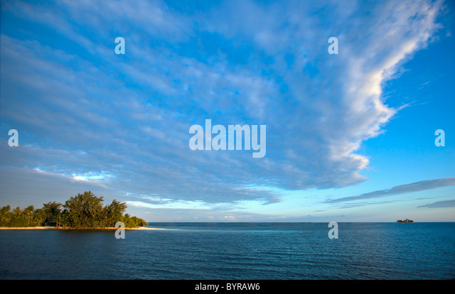 tranquil scene of an island, ocean and blue sky; belize, central america - Stock Image