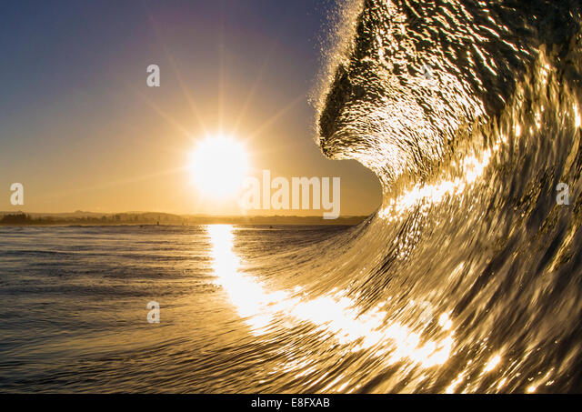 Ocean wave in sunlight - Stock Image