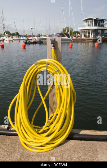 hose hoses pipe pipes hosepipe hosepipes outdoor tap taps water tube pressure flow - Stock Image