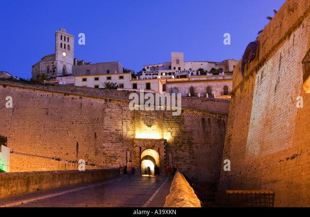 Spain Baleares island Ibiza Dalt vila fortress at night Portal de ses Taules - Stock Image