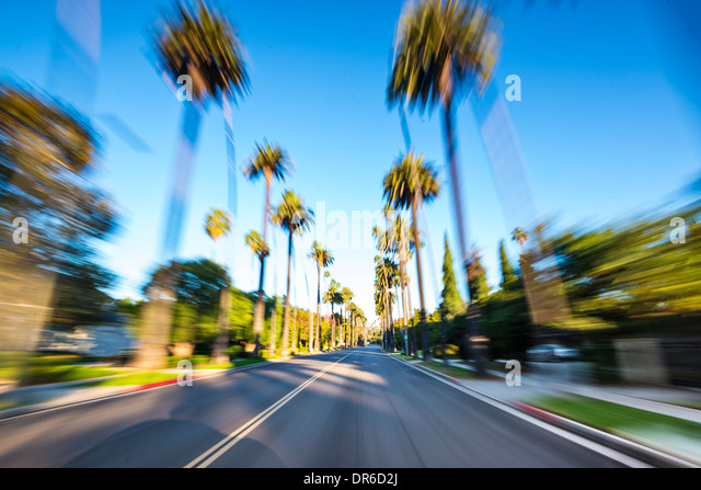 Beverly Hills drive through with motion blur. - Stock Image