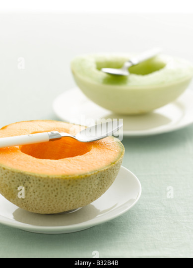 Cantaloupe and Honeydew melon selective focus - Stock Image