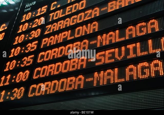 departure times of spanish trains on information board - Stock-Bilder