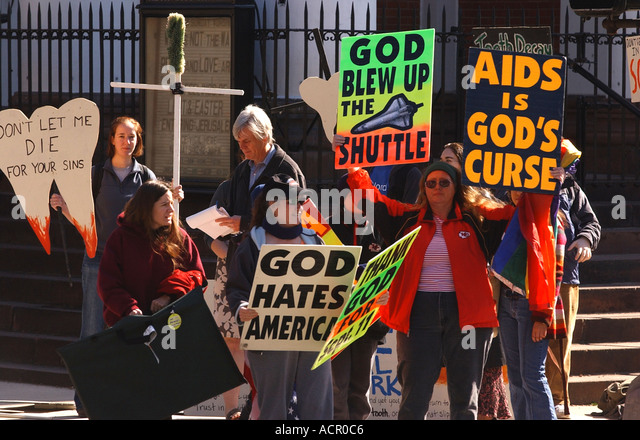 Anti gay hate activists with signs - Stock Image