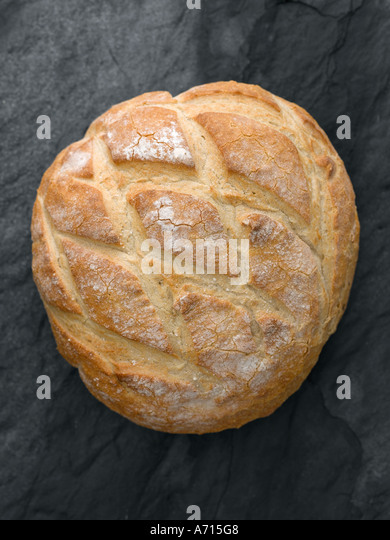 White crusty bread on slate - high end Hasselblad 61mb digital image - Stock Image