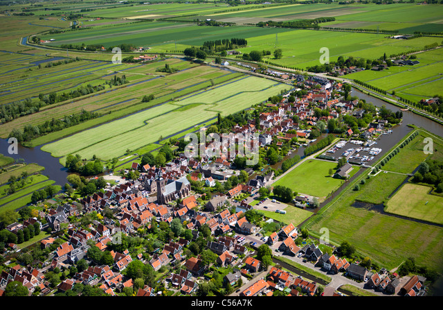 The Netherlands, De Rijp, Village in polder with farmland. Aerial. - Stock Image