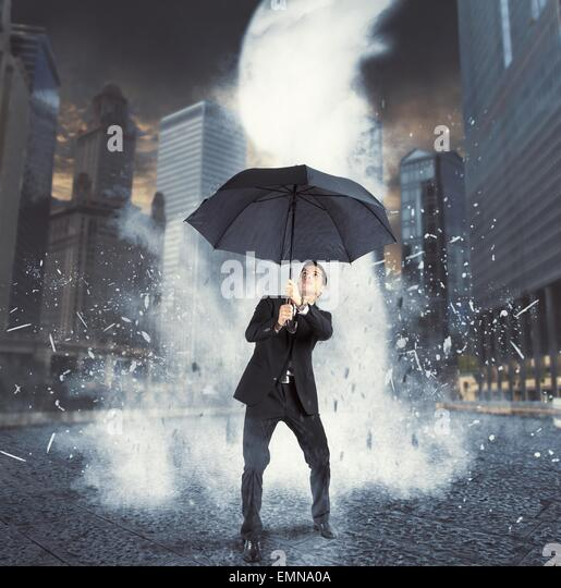 Businessman against ice flow - Stock Image