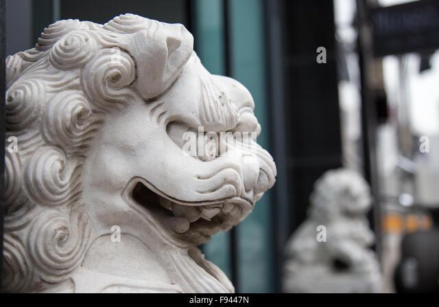 Fierce chinese dragon lion sculpture - Stock Image