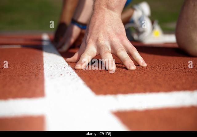 Close up of athlete's hand on track - Stock-Bilder