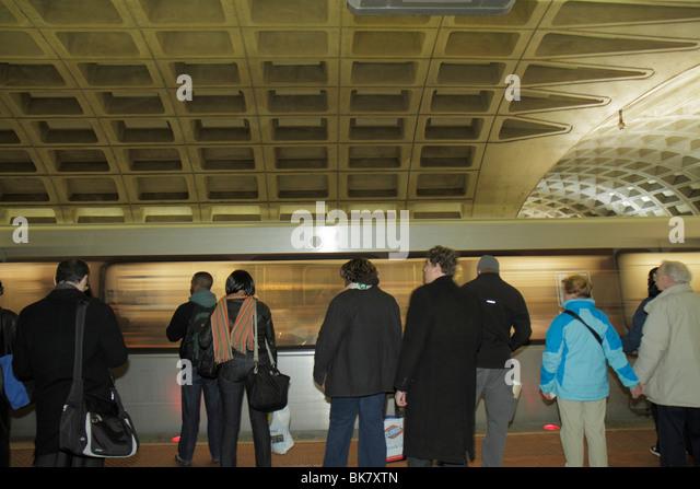 Washington DC Metro Center Metrorail Station rapid transit system public transportation train platform Black woman - Stock Image
