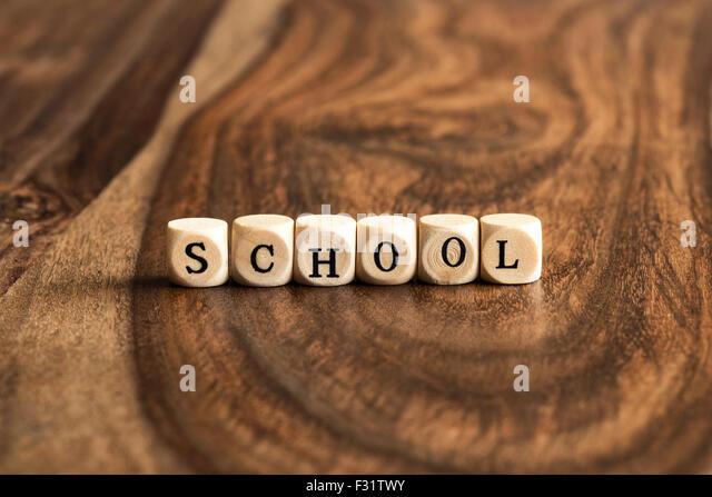 SCHOOL word background on wood blocks - Stock Image