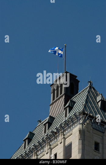 Quebec Canada old city quebec flag municipal building iconic quebec symbol - Stock Image
