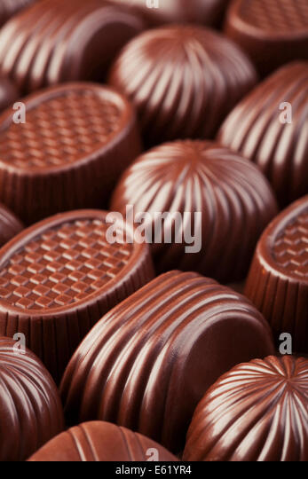 Assorted delicious chocolate candies background - Stock-Bilder