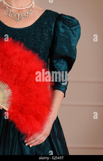 vintage woman holding red feather fan - Stock-Bilder