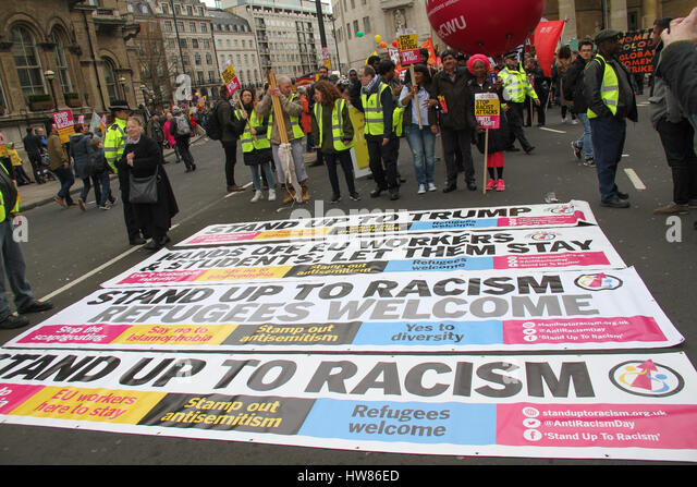 London, UK. March 18, 2017: Banners are laid on the road ahead of the  Stand Up To Racism demonstration on UN Anti - Stock Image