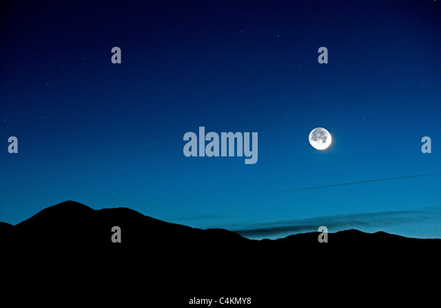 New crescent moon from Poncha Pass, Chaffee County, Colorado, USA. - Stock Image