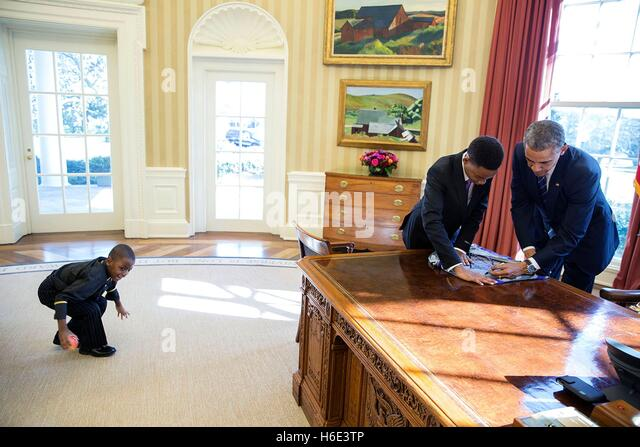 U.S. President Barack Obama signs a poster for 13-year-old student Vidal Chastanet after their Humans of New York - Stock Image