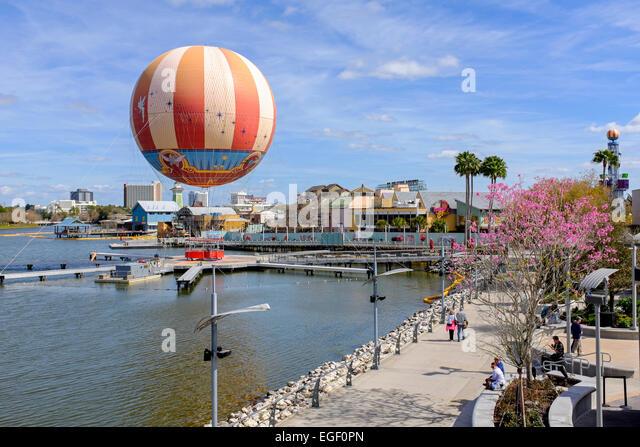 Colourful aerial balloon and palm trees at Downtown Disney, Orlando, Florida, USA - Stock Image