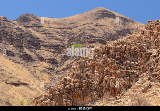 Rocky Hills Palmwag Kaokoland Kunene Region Namibia Africa Travel Nature rocks - Stock Image