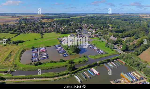 Aerial view of the canal basin at Rufford Lancashire. In the distance is the Ribble Estuary and coast line. - Stock Image