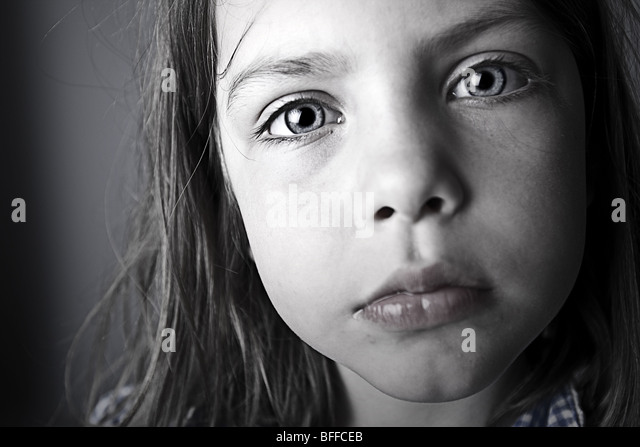 Close Up Shot of an Intense Child - Stock Image