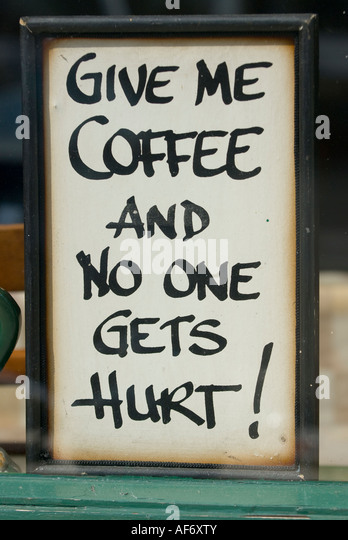 Give me coffee and no one gets hurt sign Bushmills Co Antrim - Stock Image