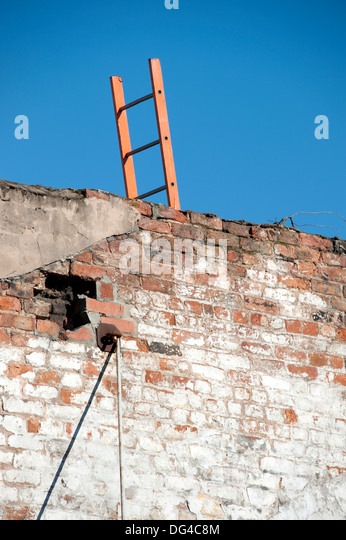 Ladder wall overcome climb over sky obstacle - Stock Image