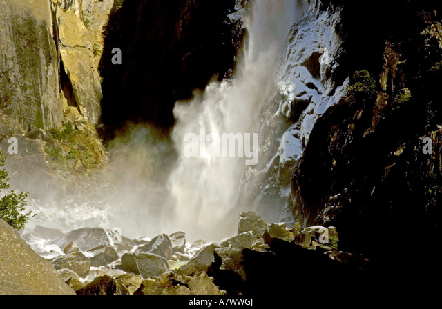 Yosemite Falls lower falls basin base pool light snow - Stock Image