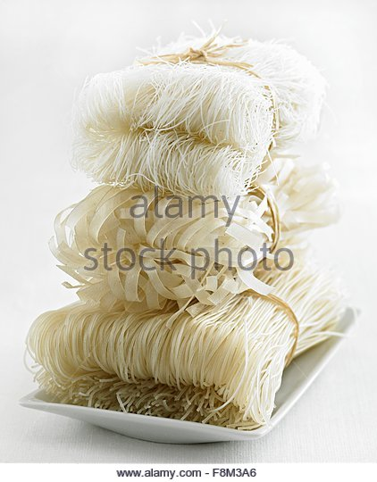 Various types of rice noodles, stacked - Stock Image