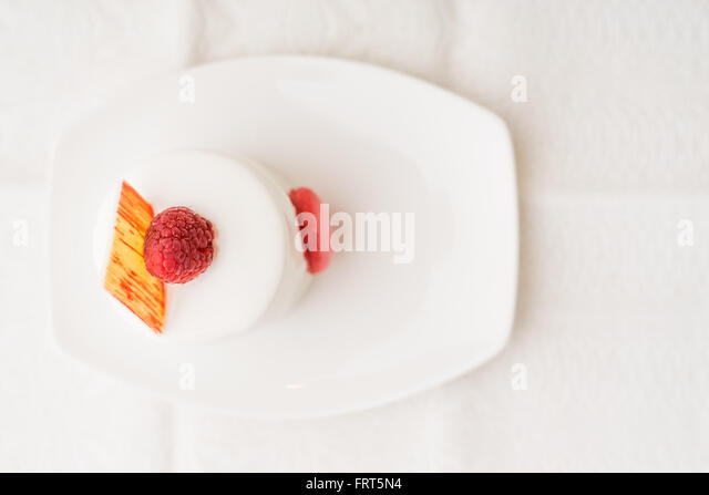 White cake with raspberry top view - Stock Image