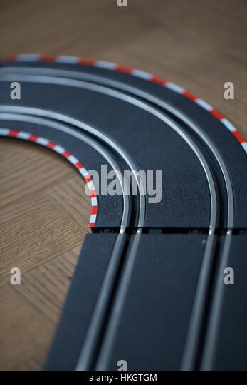 toy racing track. game, children's room, wooden floor, racetrack. - Stock Image