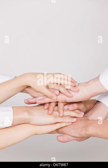 Joining hands - Stock-Bilder