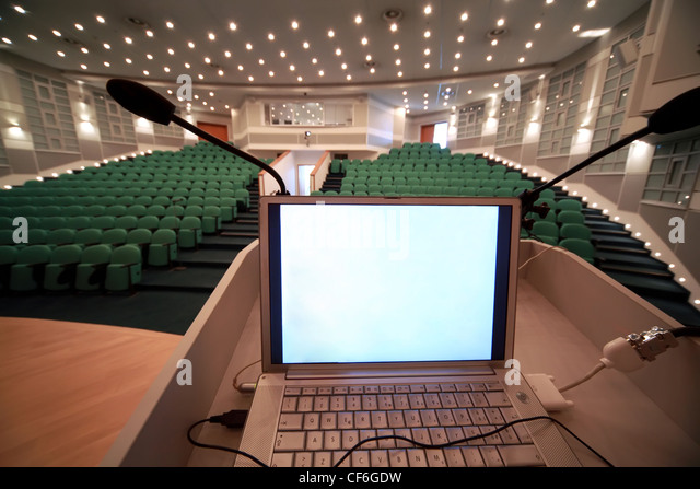 Included laptop for work of  manager at conference in  conference room. - Stock Image