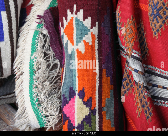 Traditional textiles on sale in Souq Waqif, Doha. - Stock Image