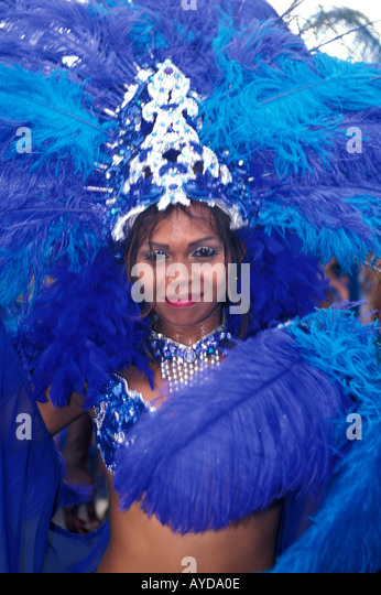 Trinidad Carnival woman in colorful blue costume - Stock Image