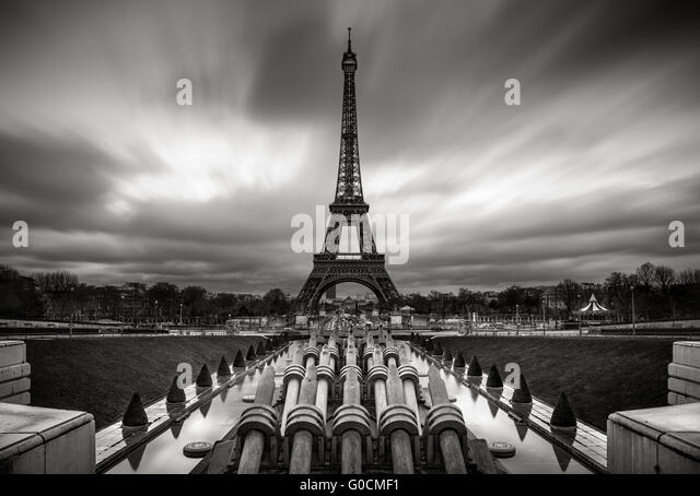 Eiffel Tower and Trocadero at sunrise with fast moving clouds, Paris, France. Black & White. - Stock Image