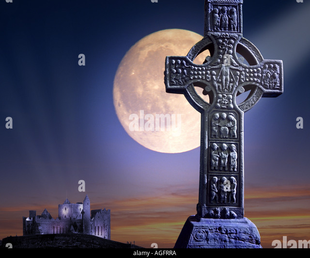 IRISH CONCEPT:  Celtic Muiredach's Cross and Rock of Cashel with moon - Stock-Bilder